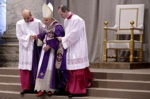 Aides assist pope as he begins Ash Wednesday Mass at Vatican