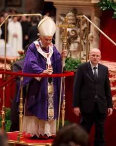 Pope leaves on wheeled platform after celebrating Ash Wednesday Mass at Vatican