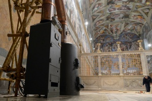 Stoves used to burn ballots during a papal conclave are seen in the Vatican's Sistine Chapel March 8. Cardinal electors assembled in Rome will begin voting for the next pope March 12. (March 8, 2013) (CNS photo/L'Osservatore Romano)