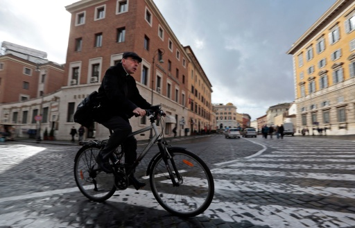 Cardinal Philippe Barbarin of Lyon, France, rides his bicycle as he arrives for the general congregation meetings in the synod hall at the Vatican March 11. The world's cardinals will enter the conclave March 12 to elect the new pope. (CNS photo/Eric Gaillard, Reuters) (March 11, 2013)