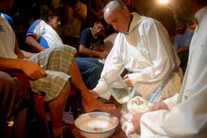 Argentine Cardinal Jorge Mario Bergoglio washes the feet of residents of a shelter for drug users during Holy Thursday Mass in 2008 at a church in a poor neighborhood of Buenos Aires, Argentina. The 76-year-old Jesuit became the first Latin American pope March 13, taking the name Francis. (CNS photo/Enrique Garcia Medina, Reuters) (March 15, 2013)