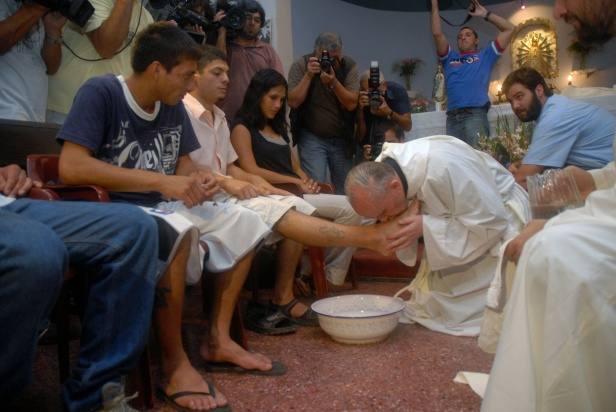 Argentine Cardinal Jorge Mario Bergoglio washes and kisses the feet of residents of a shelter for drug users during Holy Thursday Mass in 2008 at a church in a poor neighborhood of Buenos Aires, Argentina. The 76-year-old Jesuit became the first Latin American pope March 13, taking the name Francis. (CNS photo/Enrique Garcia Medina, Reuters) (March 15, 2013)
