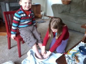 The Rice children participating in a foot-washing ritual at home, on Holy Thursday.