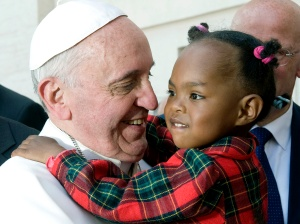 Pope Francis greets a child after celebrating Mass on the feast of Pentecost in St. Peter's Square at the Vatican May 19. (CNS photo/Alessia Giuliani, Catholic Press Photo)