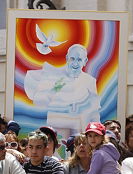 A painting of Pope Francis is seen in the crowd as the pope leads his general audience in St. Peter's Square at the Vatican May 22. (CNS photo/Paul Haring)