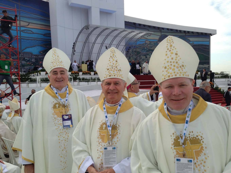 From left, Fairbanks Bishop Donald Kettler, Anchorage Archbishop Roger Schwietz and Juneau Bishop Edward Burns prepare for the Sunday Mass at World Youth Day in Rio de Janeiro, Brazil. The July 28 Mass, which was moved from its original location in western Rio de Janeiro due to heavy rains, drew an estimated 3.2 million people.