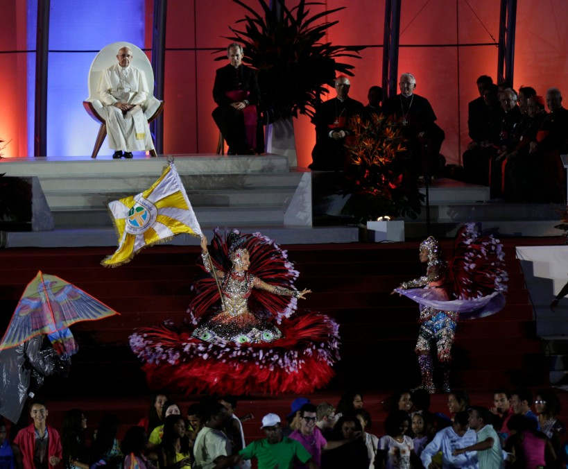 Pope Francis watches as dancers perform during the World Youth Day welcoming ceremony on Copacabana beach in Rio de Janeiro July 25. (CNS photo/Ricardo Moraes, Reuters) (July 25, 2013)