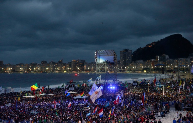 Pilgrims wait for the arrival of Pope Francis at the World Youth Day welcome ceremony on Copacabana beach in Rio de Janeiro July 25. (CNS photo/Paul Haring) (July 26, 2013)