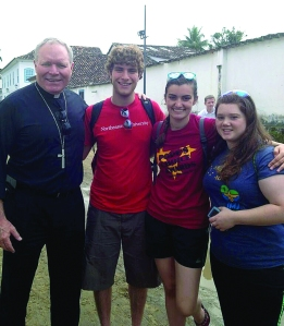 Bishop Edward Burns, Carl Uchytil, Julia Smith, and Lindsey Jobbins of the Diocese of Juneau explore Paraty—a preserved Portuguese colonial town—near Rio de Janeiro during the World Youth Day pilgrimage.
