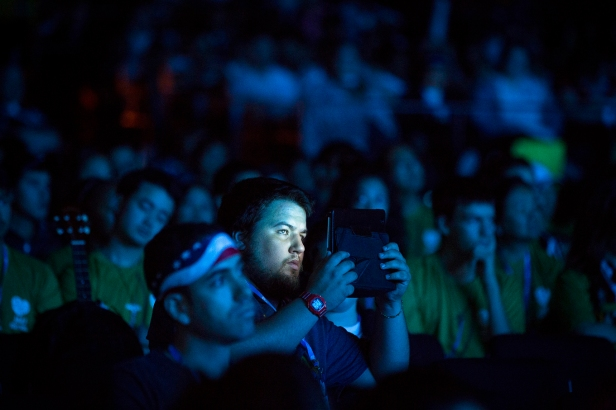 Jake Coffman, 23, a World Youth Day pilgrim from Juneau, Alaska, checks his electronic device during a lecture at the Rio Vivo Welcome Center in Rio de Janeiro July 24. (CNS photo/Tyler Orsburn)