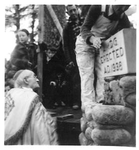 Bishop Crimont, age 80 year, watches stone mason, Doc Holden, place the Shrine Chapel cornerstone on October 30, 1938.