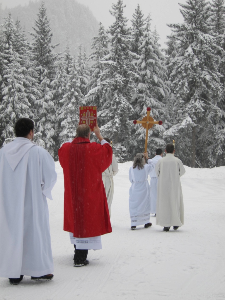 Deacon Charles Rohrbacher carries the book of the Gospels at the beginning of the procession from St. Peter's Hall into St. Paul the Apostle church for the opening mass of the Diocese of Juneau Synod 2013.