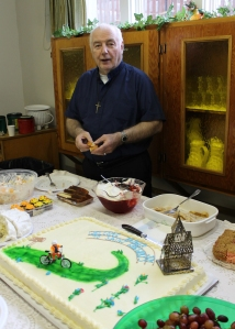 St. Gregory parish in Sitka welcomed Fr. Jim in February of 2012 with a custom cake of a bicyclist.