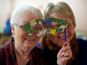 Tisket Seslar, left, and Sister Dee Sizler tryout a mask together at the Mardi Gras Masquerade Gala at the Baranof Hotel on Friday. The Gala, a fundraiser for the Shrine of St. Therese, included a sit down dinner, live music, silent auction, and outcry dessert auction.  The goal is to raise $25,000 to pay for the Shrine's septic system upgrades.