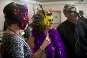 Shrine supporters don masks to support the Shrine of St. Therese at the fundraising auction and Gala, Feb. 21, 2014.  (Photo Michael Penn)