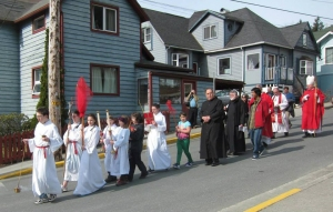 Parishioners of the Cathedral of the Nativity and of Holy Trinity  Episcopal join together for an outdoor Palm Sunday in downtown Juneau, April 13, 2014  procession