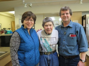 Deacon Vince Hansen and his wife, Jansy, share stories with Haines Assisted Living Facility resident, Lucy Harrell.