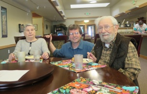 Deacon Hansen visits with Erma Schnabel and Ray Menaker in the Haines Assisted Living dining room.  (Photos by Christine Hansen)