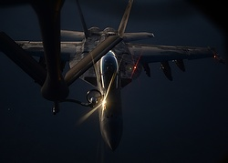 A handout picture made available by the U.S. Department of Defense Aug. 27 shows a U.S. Air Force fighter jet refueling over northern Iraq Aug. 21. Catholic experts are debating the just-war theory in light of the current threat from the Islamic State and past Iraq wars. (CNS photo/Staff Sgt. Shawn Nickel, courtesy U.S. Department of Defense, via EPA)