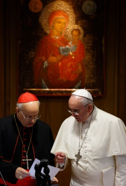 Pope Francis talks with Cardinal Baldisseri, general secretary of the Synod of Bishops, during morning session on final day of extraordinary Synod of Bishops on the family at Vatican