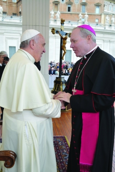 Bishop Edward J. Burns is greeted by Pope Francis on Oct. 29th, 2014, in St. Peter's Square. Bishop Burns was in Rome with the Diocese of Juneau 'Partners in Faith' pilgrimage.