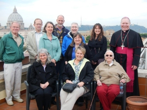 Partners in Faith pilgrims gather on the rooftop of the North American College in Rome: (top row, l-r) Terry Thompson, Mark Scheibe, Margaret Scheibe, Joe Robidou, Fr. Pat Travers, Deb Riva, Bishop Edward Burns. (Front row, l-r) Peggy Mattson, Janis Burns-Buyarski, Carolyn Thompson, and Eileen Casey.