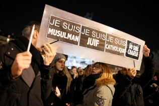 "People hold a placard that reads ""I am Muslim, I am Jewish, I am Catholic, I am Charlie"" during a Jan. 8 vigil in Paris, following the mass shooting at the offices of Charlie Hebdo, a satirical newspaper in Paris. Pope Francis condemned the killings of at least 12 people at the offices of the publication Jan. 7 and denounced all ""physical and moral"" obstacles to the peaceful coexistence of nations, religions and cultures. (CNS photo/Jacky Naegelen, Reuters)"