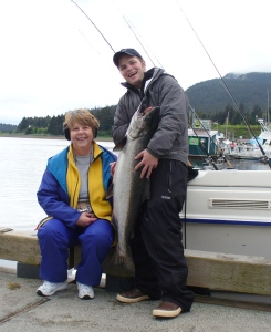 Sr. Dee poses with a  large salmon she caught near Juneau while on a fishing trip with friends.