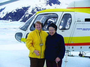 Sisters Dee Sizler (left) and Annina Morgan (right) along with S. Mary Beth Peters and Associate Linda Fry visited Juneau and the five SC Associates living there, taking a helicopter flightseeing tour to the Mendenhall Icefield.