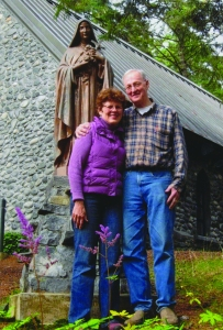 Jeanne and Jack Jordan in front of the Shrine of St. Therese chapel.