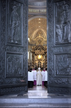 Pope Francis processes into St. Peter's Basilica to celebrate first vespers of Divine Mercy Sunday at Vatican