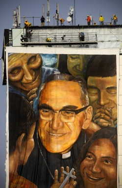 Workers hang image of Archbishop Oscar Romero near the Divine Savior of the World square in San Salvador for his May 23 beatification Mass. (CNS photo/Oscar Rivera, EPA) See ROMERO-BEATIFY May 23, 2015.