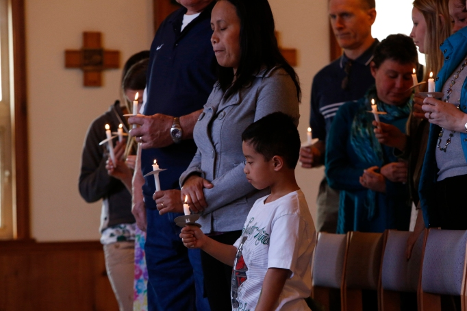 Families gather for Easter Mass at St. John by the Sea Church in Klawock on Prince of Wales Island in southeastern Alaska, April 19, 2014. (CNS photo/Nancy Wiechec)