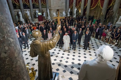 Pope Francis pauses in front of the  sculpture of St. Junipero Serra in Statuary Hall at the U.S. Capitol in Washington Sept. 24. (CNS photo/Michael Reynolds, pool)