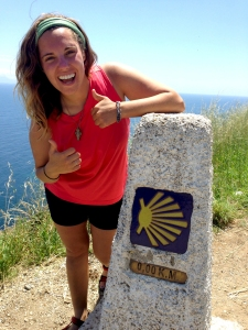 New diocesan Director of Youth Ministry, Heather Shaw, smiles at kilometer 0 of the Camino de Santiago de Compostela pilgrimage in Spain. Shaw walked the Camino last summer and calls it 'one of the coolest experiences I've had so far!'