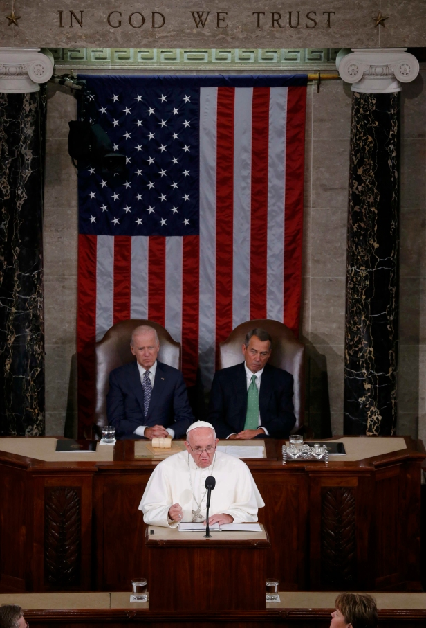 Pope Francis addresses a joint meeting of the U.S. Congress as Vice President Joe Biden (left) and Speaker of the House John Boehner look on in the House of Representatives Chamber at the U.S. Capitol in Washington Sept. 24. (CNS photo/Jim Bourg, Reuters) See POPE-CONGRESS Sept. 24, 2015.