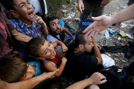 Syrian refugee children scream as they sit in front of Macedonian riot police at the Greek-Macedonian border, near the village of Idomeni, Greece, Aug. 21. Pope Francis referred to the plight of persecuted Christians during his Aug. 30 audience address. (CNS photo/Yannis Behrakis, Reuters) See AUSTRIA-MIGRANTS-TRUCK and POPE-PERSECUTION Aug. 31, 2015.