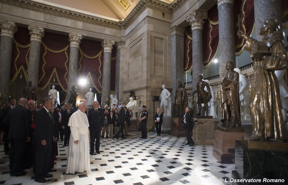 Pope Francis pauses in front of a statue of St. Junipero Serra in National Statuary Hall in the U.S. Capitol in Washington Sept. 24. Standing next to the pope is John Boehner, speaker of the United States House of Representatives. (CNS photo/L'Osservatore Romano, handout)