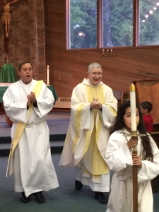Deacon Mike Galbraith, left, assists at Mass at Holy Name in Ketchikan with Fr. Pat Travers.