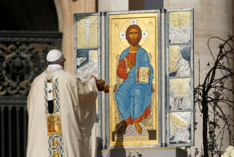 Pope Francis uses incense to reverence an icon of the risen Jesus at the beginning of Easter Mass in St. Peter's Square at the Vatican March 27. (CNS photo/Paul Haring) See POPE-EASTER March 27, 2016.