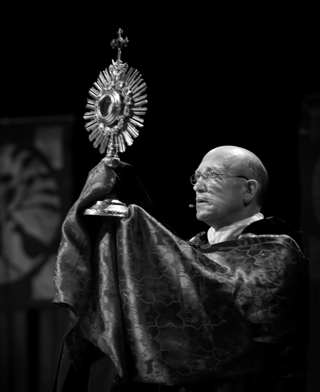 Bishop Edward M. Rice is pictured holding a monstrance in late February as he leads a Eucharistic Benediction during the annual Catholic Women for Christ Conference at Lindenwood University in St. Charles, Mo. Pope Francis has appointed Bishop Rice to head the Diocese of Springfield-Cape Girardeau, Mo. He had been auxiliary bishop in the St. Louis Archdiocese. The appointment was announced April 26 in Washington. (CNS photo/Lisa Johnston, St. Louis Review) See BISHOP-RICE-SPRINGFIELD-CAPEGIRARDEAU April 26, 2016.
